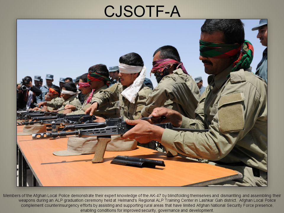 CJSOTF-A Members of the Afghan Local Police demonstrate their expert knowledge of the AK-47 by blindfolding themselves and dismantling and assembling