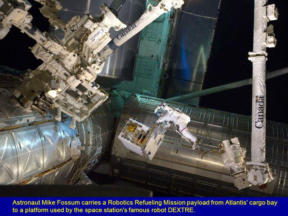 Astronaut Ronald Garan leaves the Quest airlock on the International Space Station.