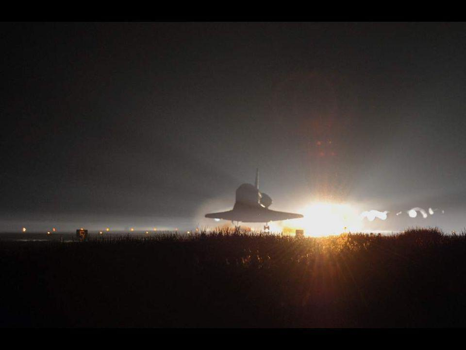 The drag chute is deployed as the space shuttle Atlantis lands at the Kennedy Space Center in Florida, completing STS-135, the final mission of the NASA shuttle program.