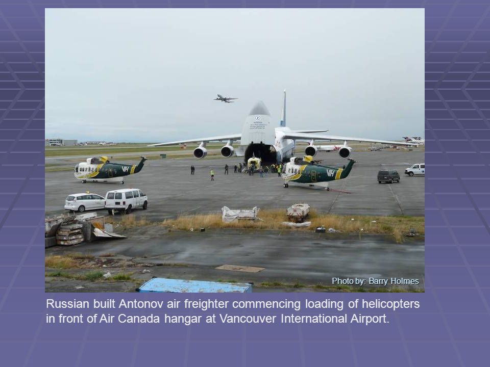 Photo by: Barry Holmes Russian built Antonov air freighter commencing loading of helicopters in front of Air Canada hangar at Vancouver International Airport.