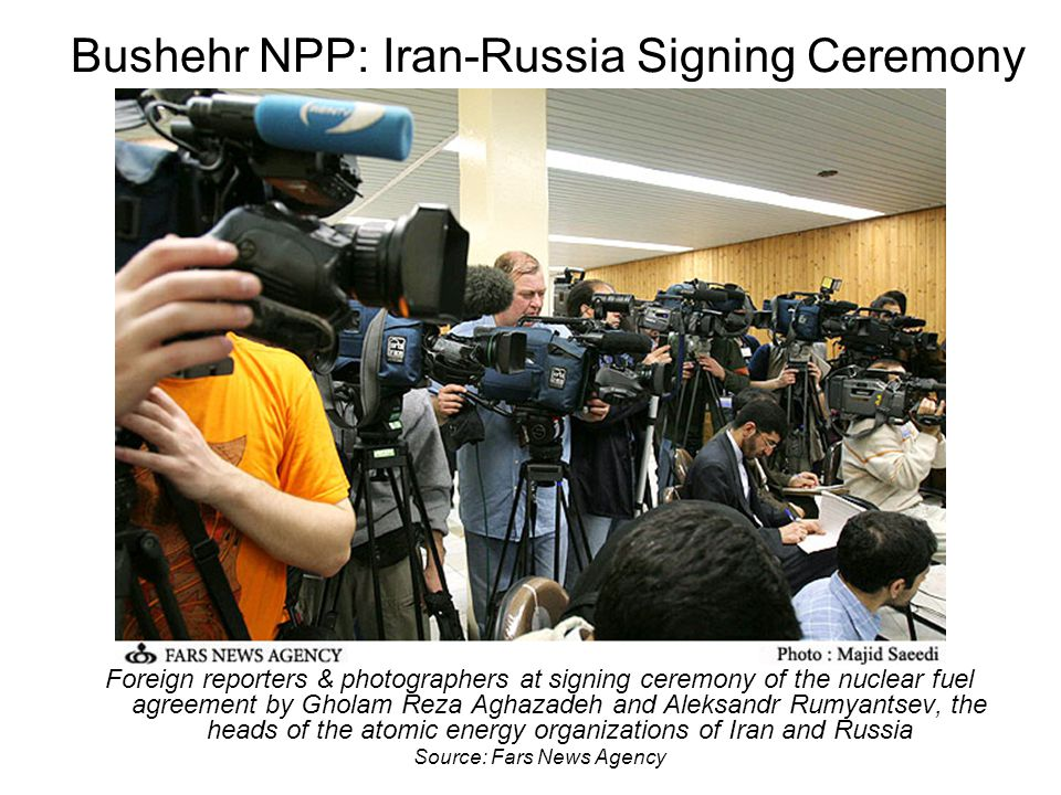 Bushehr NPP: Iran-Russia Signing Ceremony Foreign reporters & photographers at signing ceremony of the nuclear fuel agreement by Gholam Reza Aghazadeh