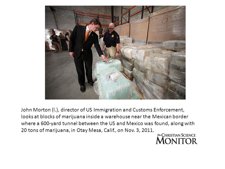 John Morton (l.), director of US Immigration and Customs Enforcement, looks at blocks of marijuana inside a warehouse near the Mexican border where a 600-yard tunnel between the US and Mexico was found, along with 20 tons of marijuana, in Otay Mesa, Calif., on Nov.
