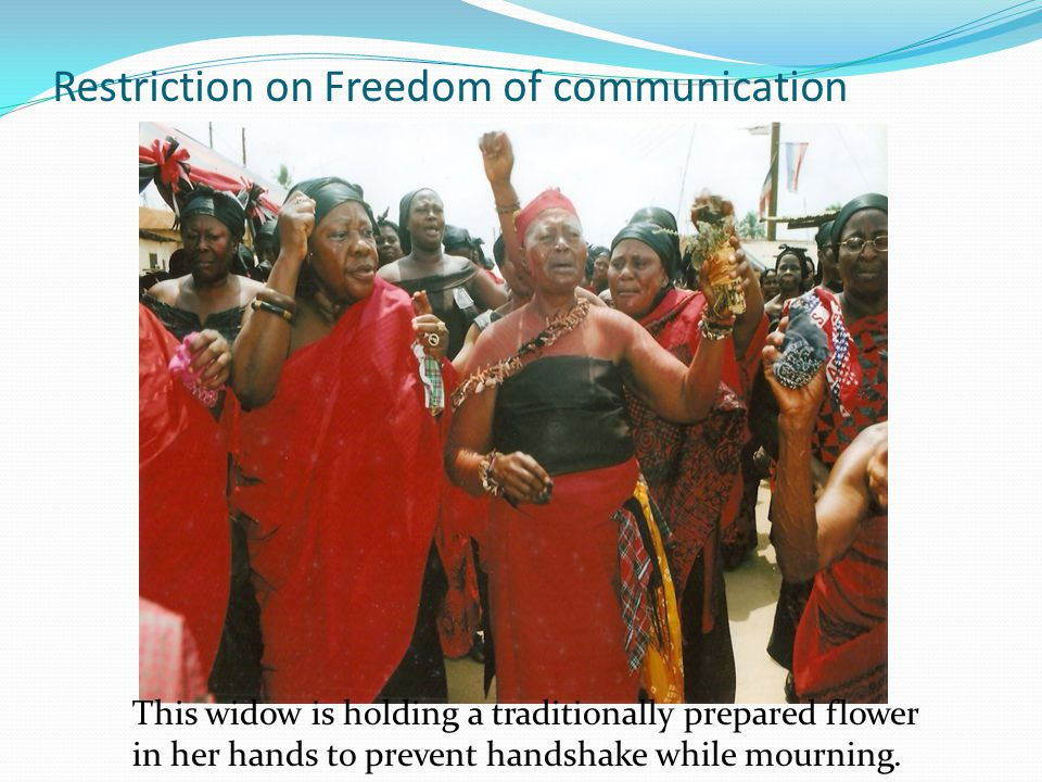 Restriction on Freedom of communication This widow is holding a traditionally prepared flower in her hands to prevent handshake while mourning.