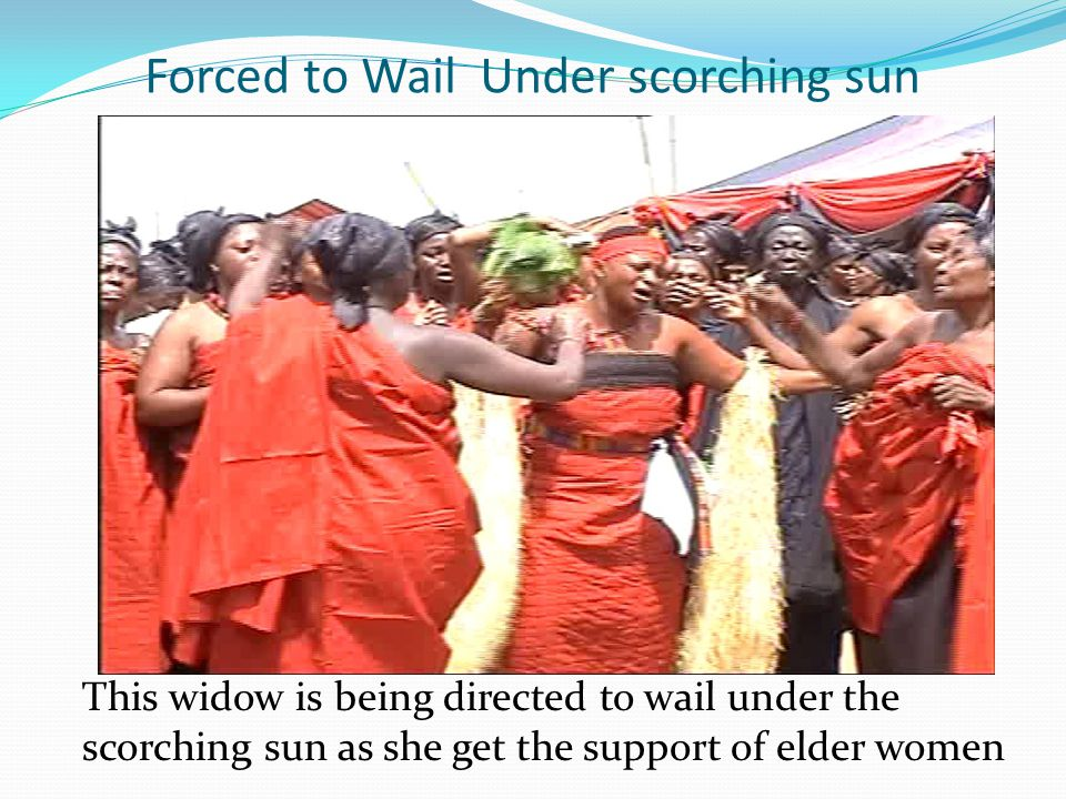Forced to Wail Under scorching sun This widow is being directed to wail under the scorching sun as she get the support of elder women