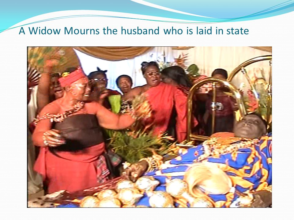 A Widow Mourns the husband who is laid in state