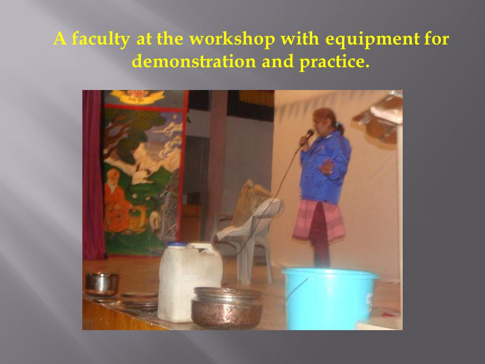 A faculty at the workshop with equipment for demonstration and practice.