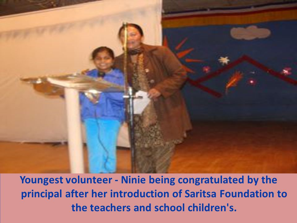 Youngest volunteer - Ninie being congratulated by the principal after her introduction of Saritsa Foundation to the teachers and school children's.