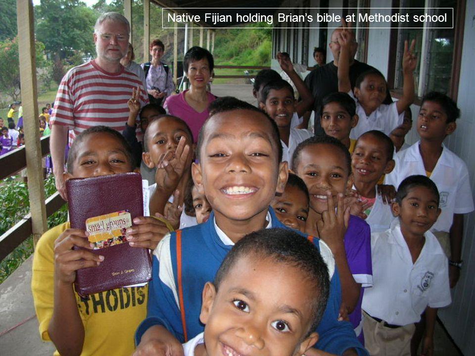 Native Fijian holding Brians bible at Methodist school