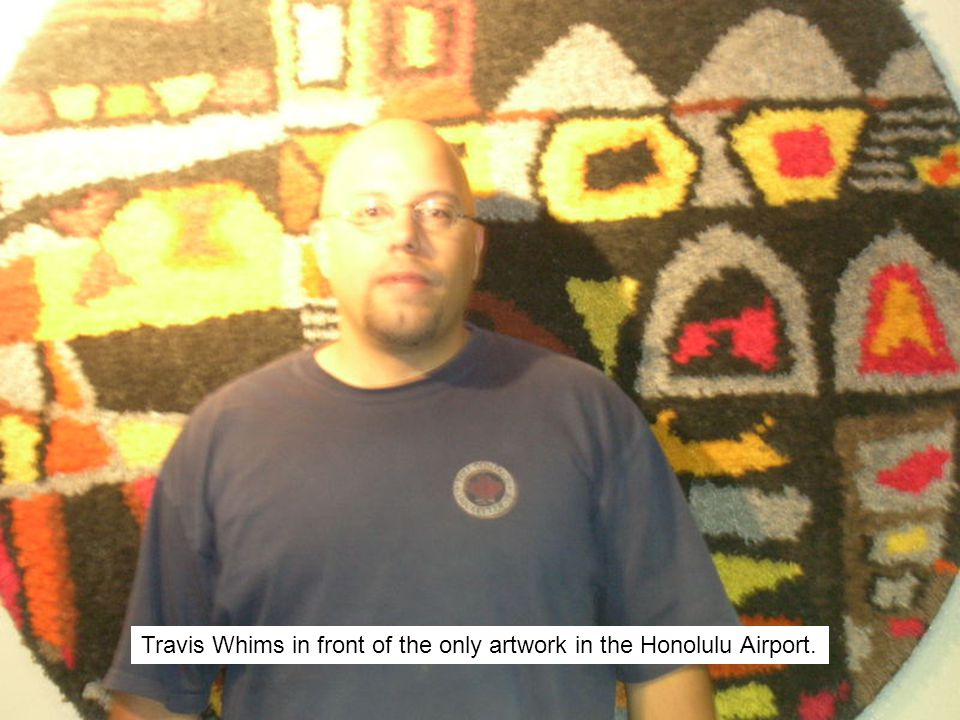 Travis Whims in front of the only artwork in the Honolulu Airport.