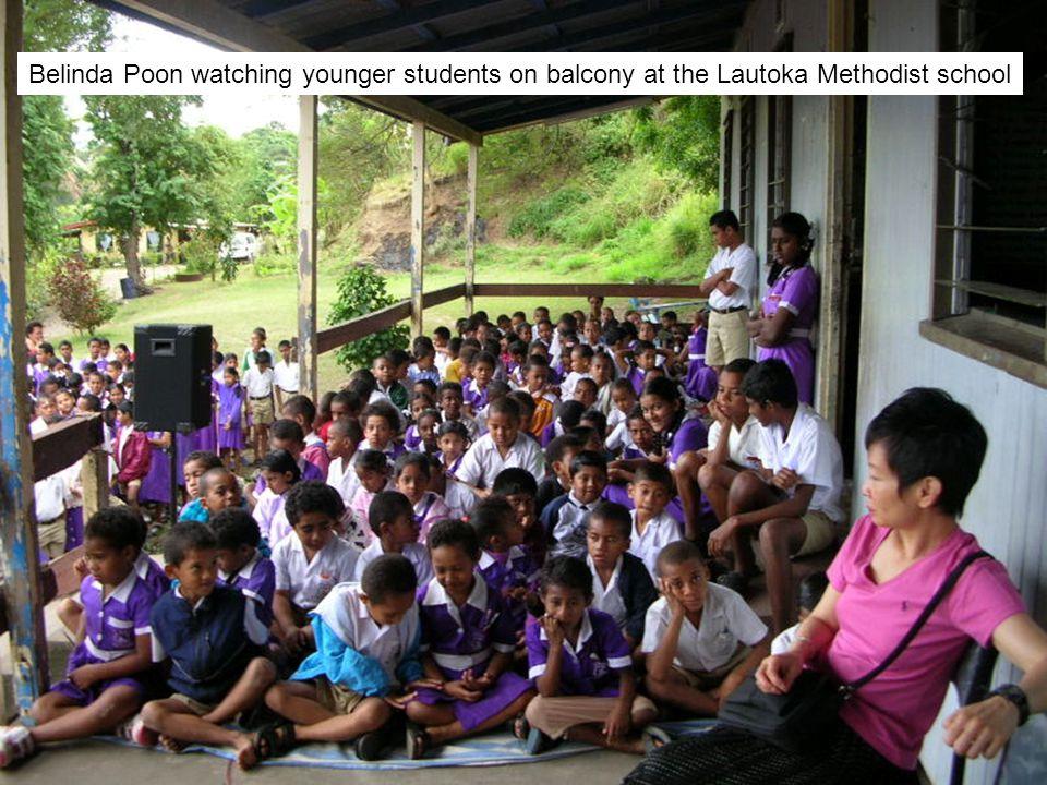 Belinda Poon watching younger students on balcony at the Lautoka Methodist school