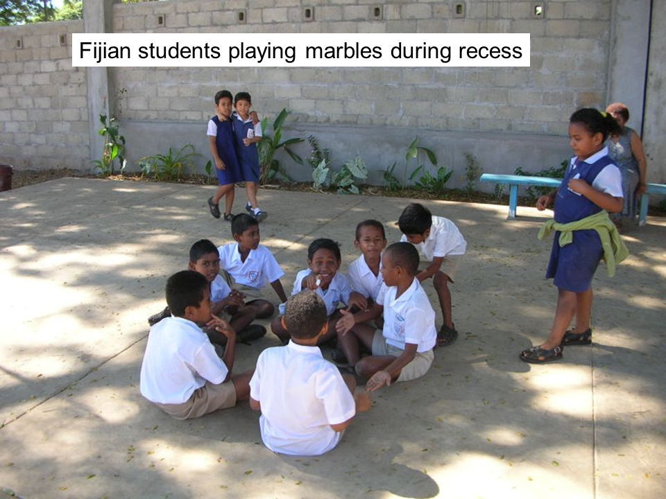 Fijian students playing marbles during recess