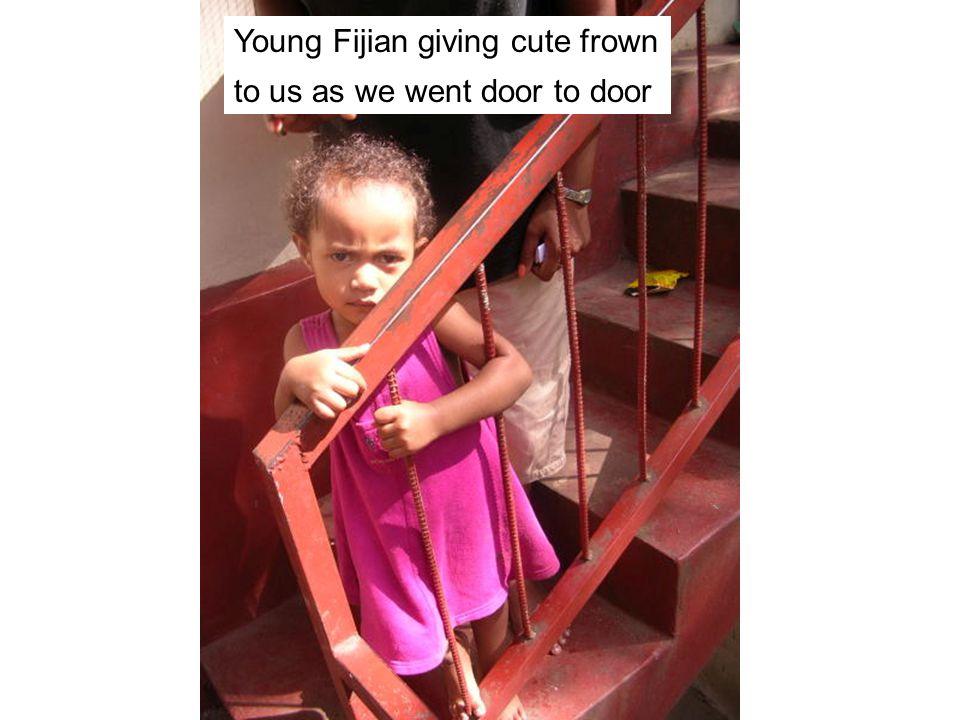 Young Fijian who wasnt too sure about us as we went door to door Young Fijian giving cute frown to us as we went door to door