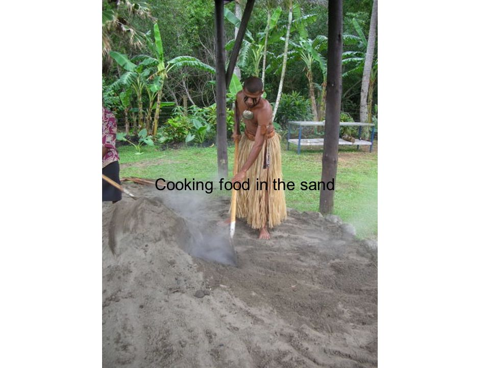 Cooking food in the sand