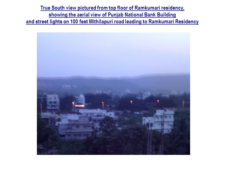 True South view pictured from top floor of Ramkumari residency, showing the aerial view of Punjab National Bank Building and street lights on 100 feet