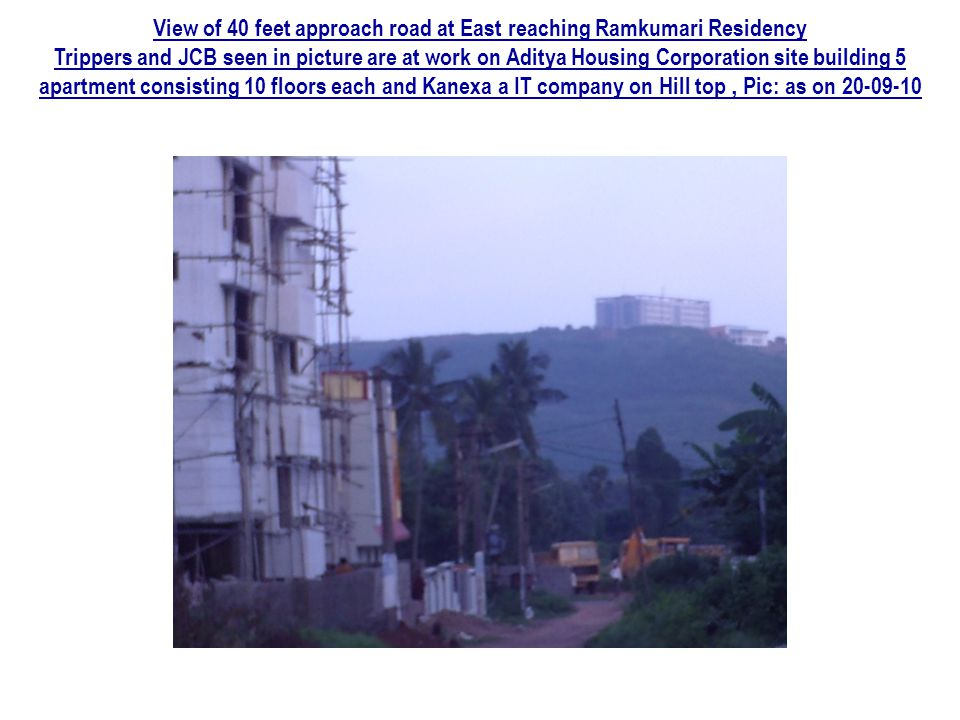 View of 40 feet approach road at East reaching Ramkumari Residency Trippers and JCB seen in picture are at work on Aditya Housing Corporation site bui