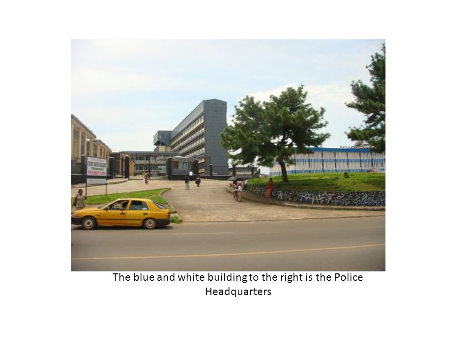 The blue and white building to the right is the Police Headquarters