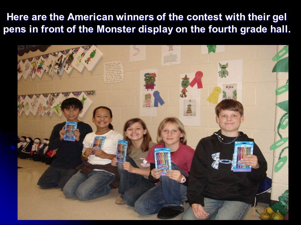Here are the American winners of the contest with their gel pens in front of the Monster display on the fourth grade hall.