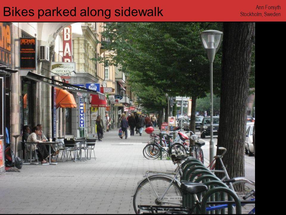 www.annforsyth.net Bikes parked along sidewalk Ann Forsyth Stockholm, Sweden