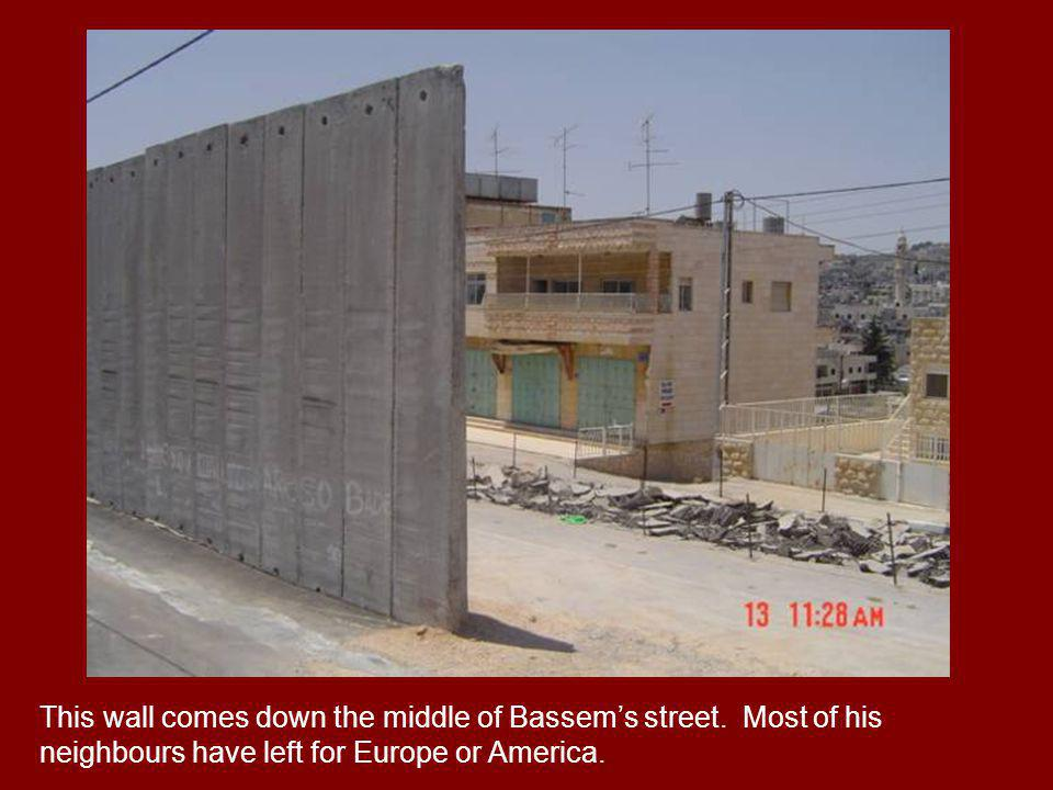 This wall comes down the middle of Bassems street. Most of his neighbours have left for Europe or America.