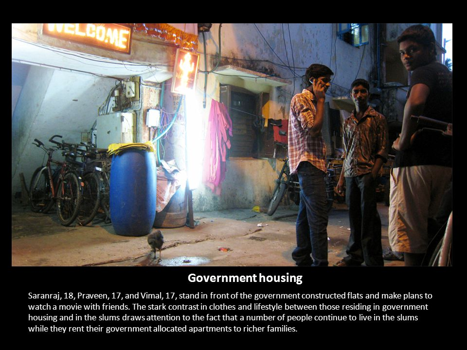 Government housing Saranraj, 18, Praveen, 17, and Vimal, 17, stand in front of the government constructed flats and make plans to watch a movie with friends.