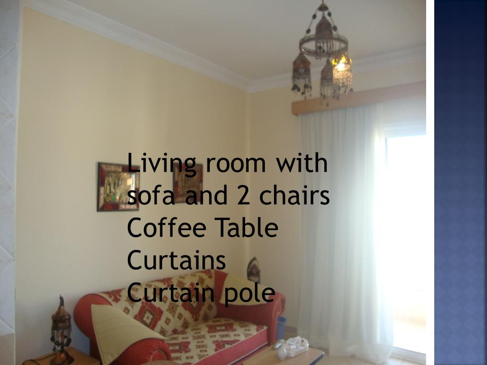 Oriental chandelier and side lamps Living room with sofa and 2 chairs Coffee Table Curtains Curtain pole