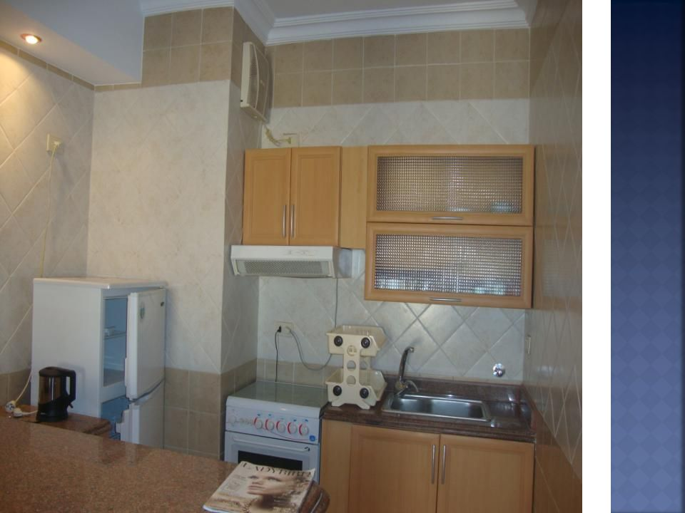 Fitted kitchen Fridge/freezer, and cooker TV, and TV stand