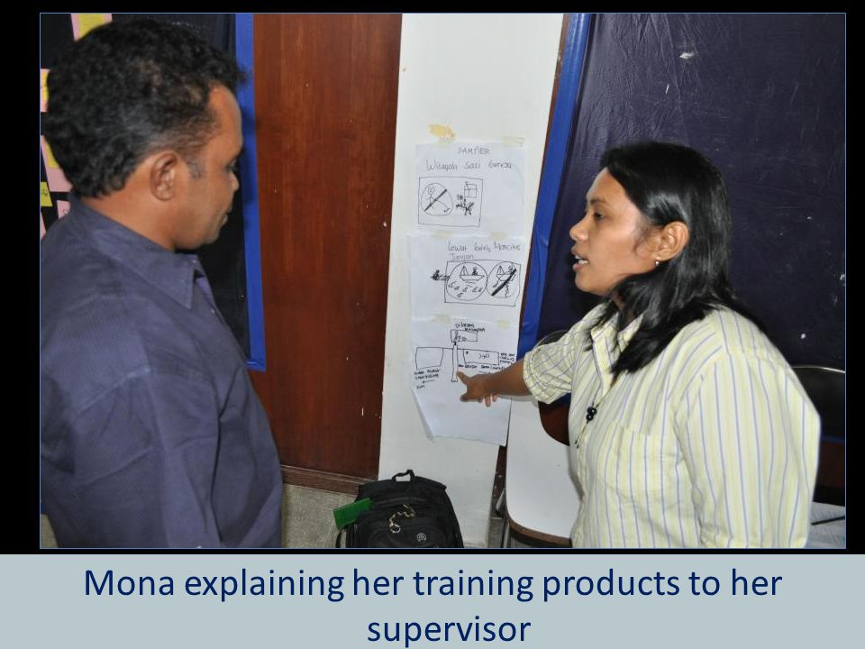 Mona explaining her training products to her supervisor