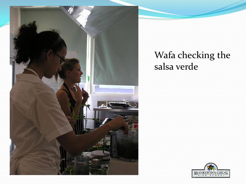 Wafa checking the salsa verde