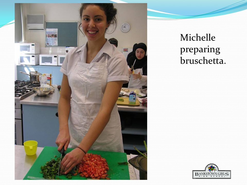 Michelle preparing bruschetta.