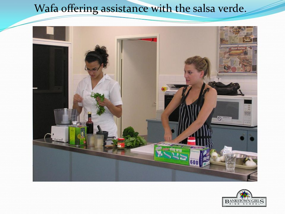 Wafa offering assistance with the salsa verde.