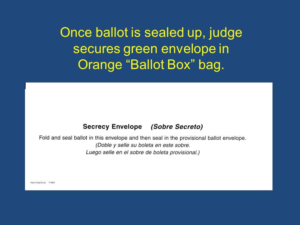 Once ballot is sealed up, judge secures green envelope in Orange Ballot Box bag.