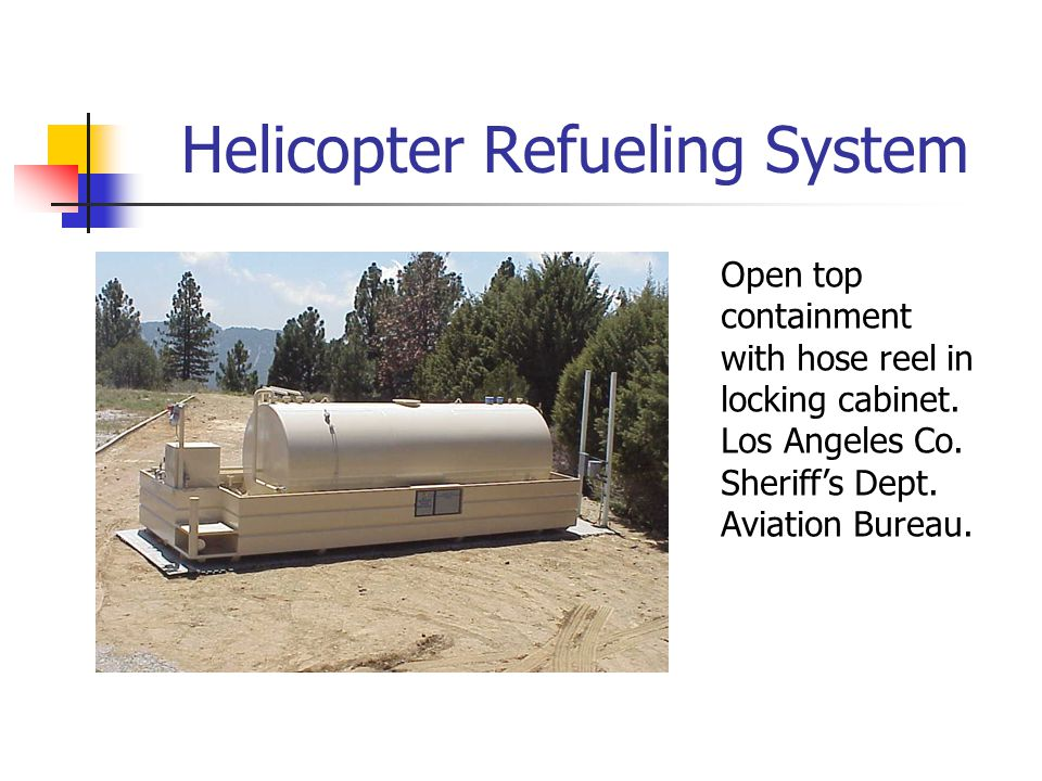 Helicopter Refueling System Open top containment with hose reel in locking cabinet.