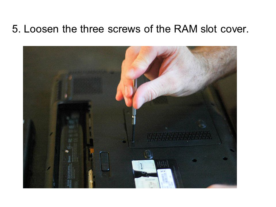 5. Loosen the three screws of the RAM slot cover.