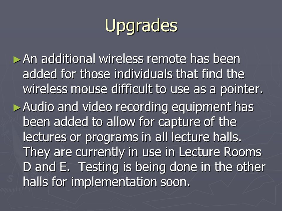 Upgrades An additional wireless remote has been added for those individuals that find the wireless mouse difficult to use as a pointer.
