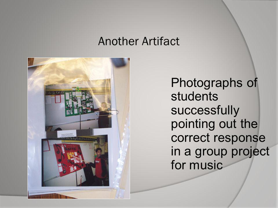 Another Artifact Photographs of students successfully pointing out the correct response in a group project for music