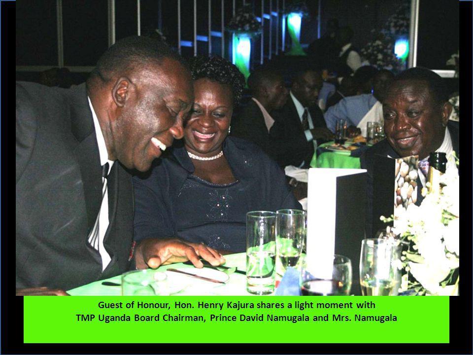 Guest of Honour, Hon. Henry Kajura shares a light moment with TMP Uganda Board Chairman, Prince David Namugala and Mrs. Namugala