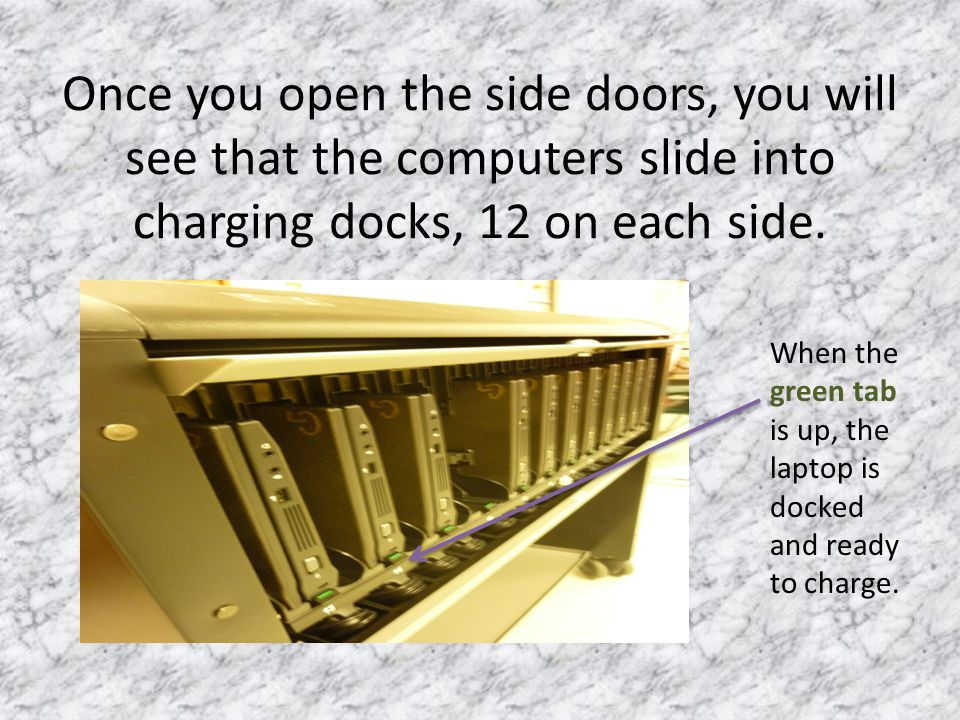 Once you open the side doors, you will see that the computers slide into charging docks, 12 on each side.