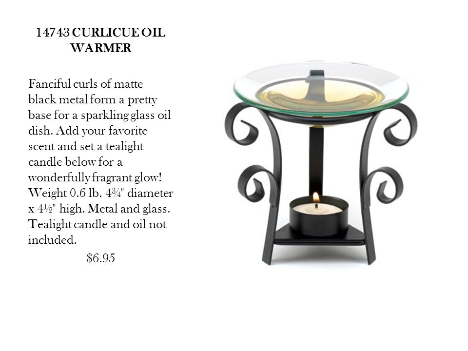 14743 CURLICUE OIL WARMER Fanciful curls of matte black metal form a pretty base for a sparkling glass oil dish.