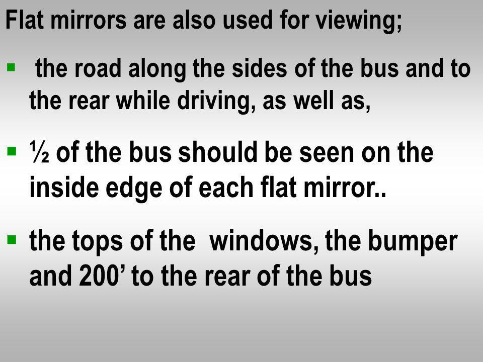 200 feet or 4 bus lengths behind the bus Along the sides of the bus * The rear tires touching the ground