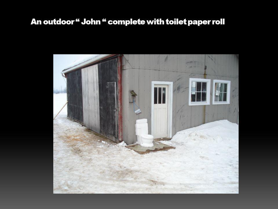 An outdoor John complete with toilet paper roll