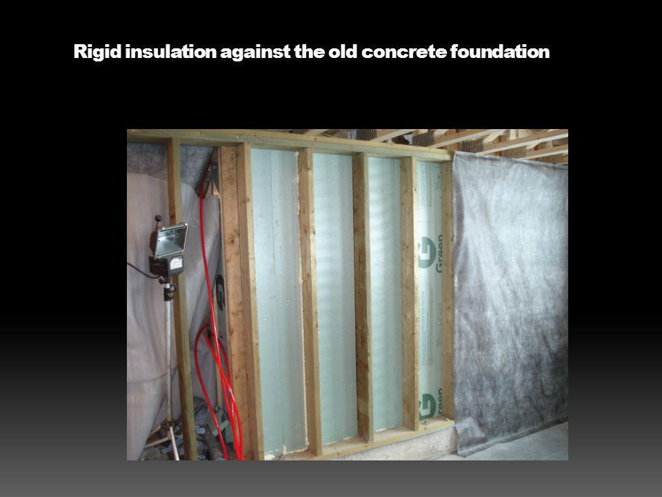 Rigid insulation against the old concrete foundation