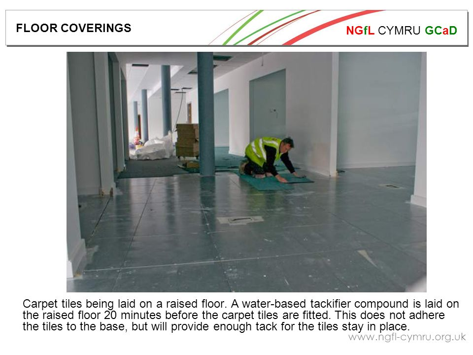 NGfL CYMRU GCaD   Carpet tiles being laid on a raised floor.