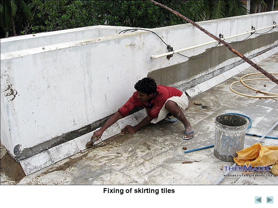 Fixing of skirting tiles