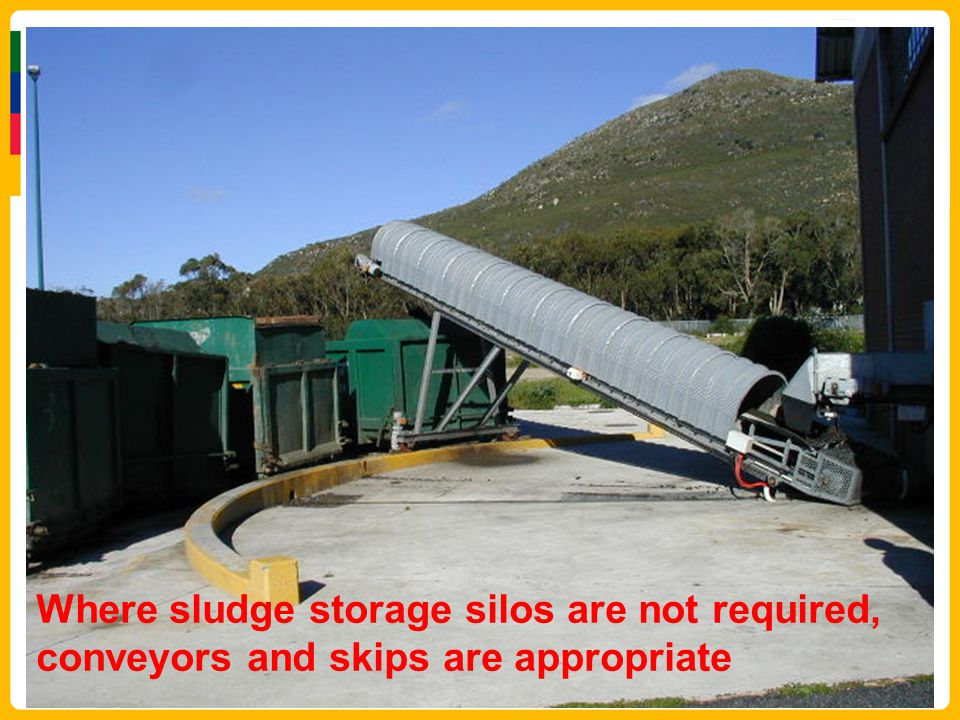 Where sludge storage silos are not required, conveyors and skips are appropriate