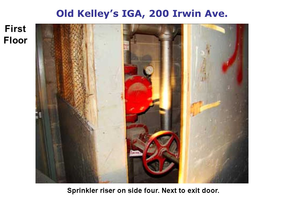 Old Kelleys IGA, 200 Irwin Ave. Sprinkler riser on side four. Next to exit door. First Floor