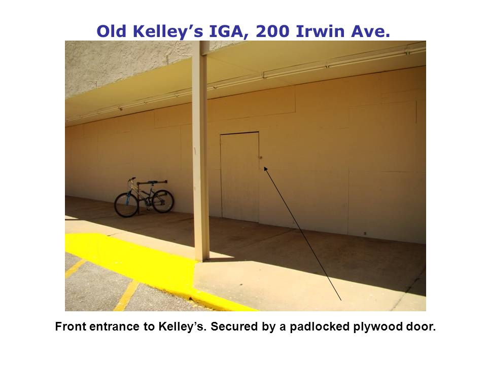 Old Kelleys IGA, 200 Irwin Ave. Front entrance to Kelleys. Secured by a padlocked plywood door.