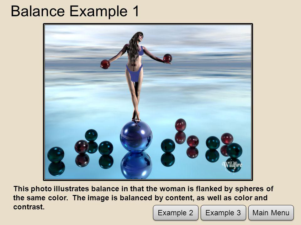 Balance Example 1 This photo illustrates balance in that the woman is flanked by spheres of the same color.