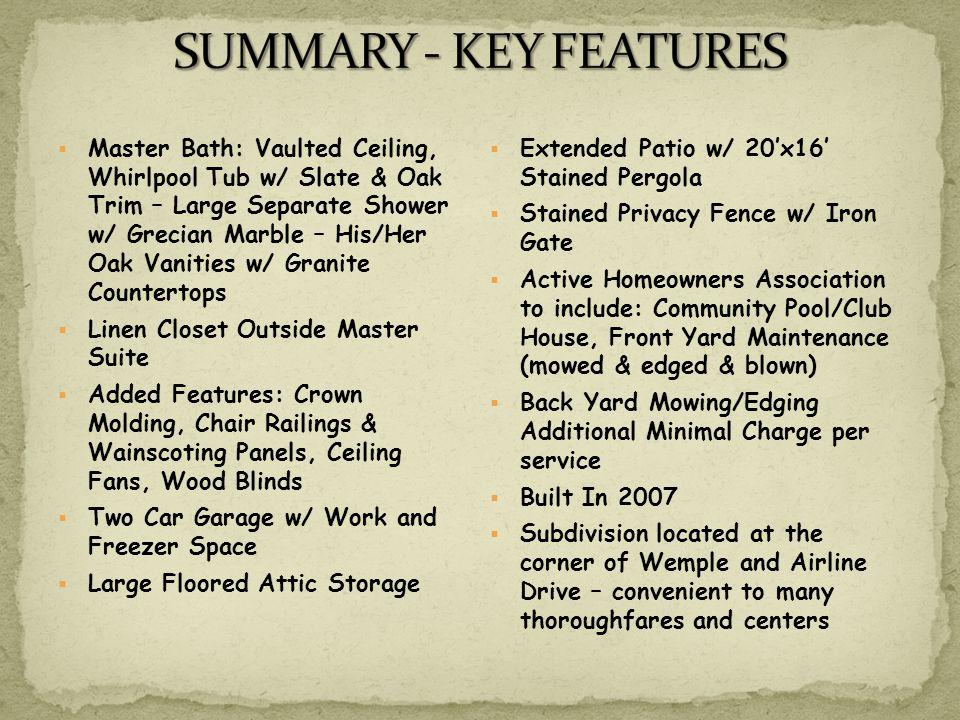 Master Bath: Vaulted Ceiling, Whirlpool Tub w/ Slate & Oak Trim – Large Separate Shower w/ Grecian Marble – His/Her Oak Vanities w/ Granite Countertop