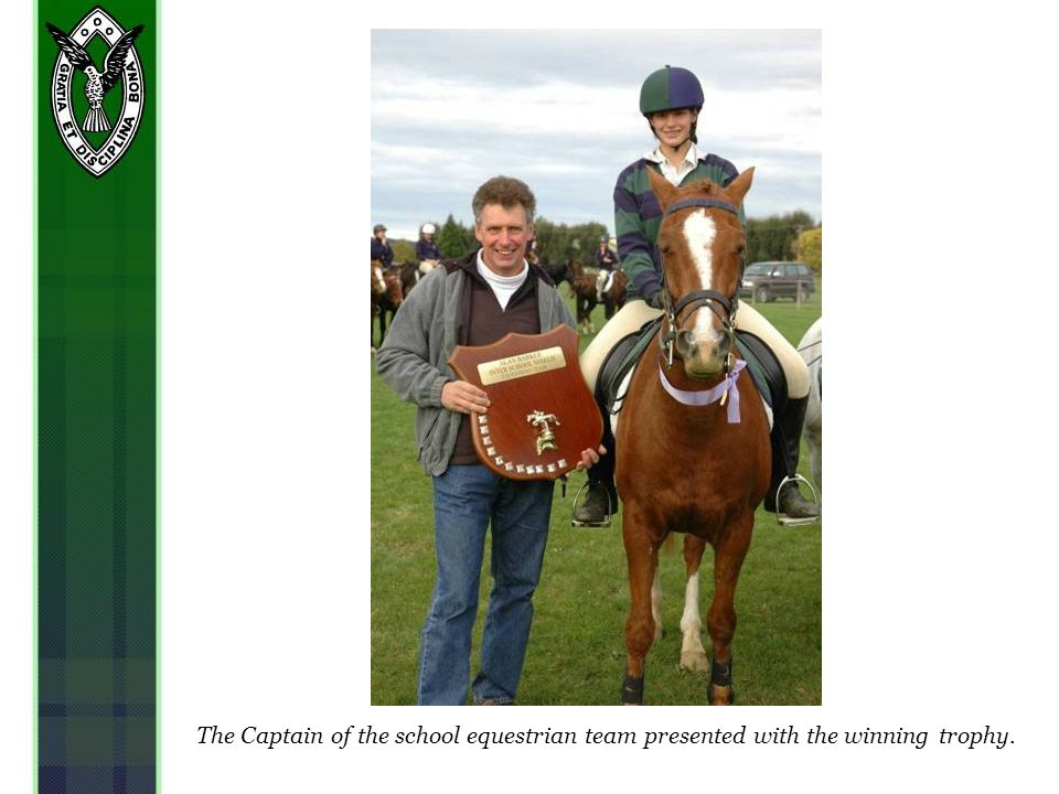 The Captain of the school equestrian team presented with the winning trophy.