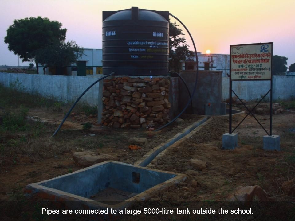 Pipes are connected to a large 5000-litre tank outside the school.